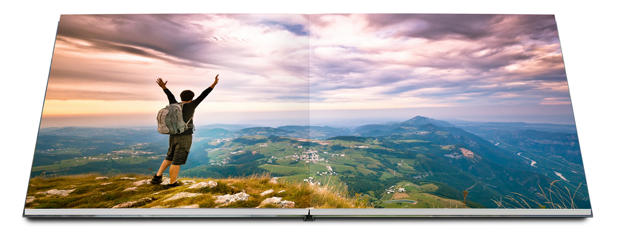 Photo book with Layflat binding and climber in front of landscape.
